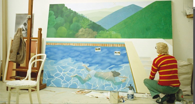 Hockney worked 18 hours a day non-stop for two weeks to finish his painting, finally completing it the night before it was due to be shipped to New York. Film still from A Bigger Splash, 1974 (present lot in progress illustrated). Photo Jack Hazan  Buzzy Enterprises Ltd. Artwork © David Hockney