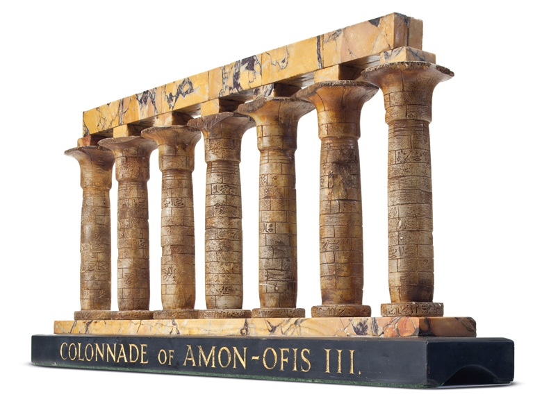 A Siena marble and tinted alabaster model of the colonnade of Amon-Ofis III (Amenhotep III), Luxor, Egypt. Italy and England, circa 1830. 16¾ in (42.5 cm) high, 36 in (91.4 cm) wide, 5½ in (13.9 cm) deep. Estimate $8,000-12,000. Offered in The Collector English and European 18th and 19th Century Furniture, Ceramics, Silver & Works of Art on 23 October at Christies in New