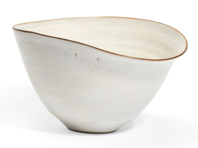 Dame Lucie Rie (1902-1995), Bowl, circa 1958. Stoneware, white glaze with manganese lip, mineral elements in the body creating a brown speckle, the rim formed to a pouring lip. 7 high x 12¼ in diameter (17.8 x 31 cm). Estimate £8,000-12,000. Offered in UnBreakable on 2 October at Christie's London