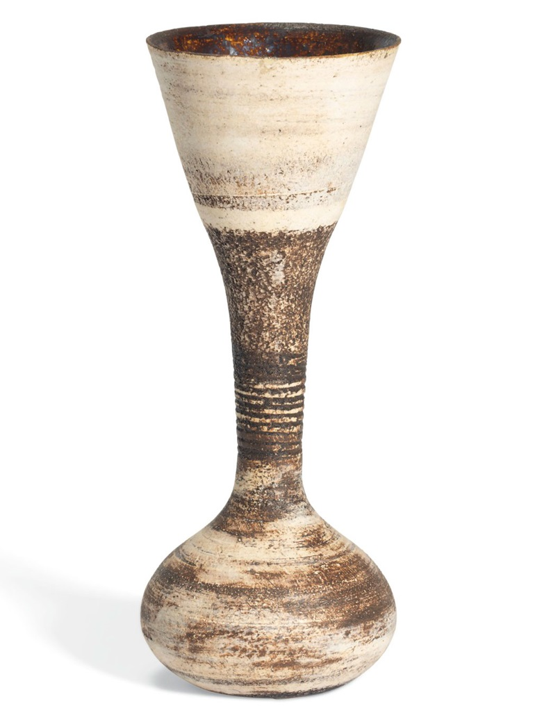 Hans Coper (1920-1981), Hourglass Vessel, circa 1970. Stoneware, layered white porcelain slips and engobes over a body with textured and incised linear designs, the interior with manganese glaze. 7½ high x 3 in diameter (19.8 x 7.5 cm). Estimate £12,000-18,000. Offered in UnBreakable on 2 October at Christie's London