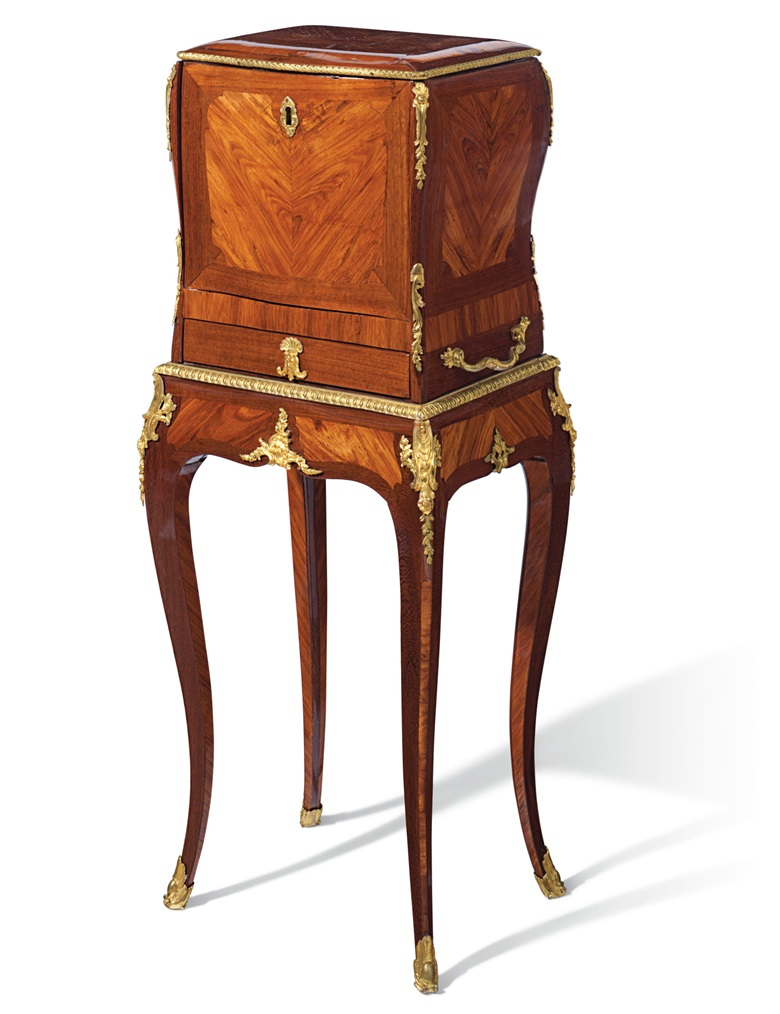 A Louis XV ormolou-mounted tulipwood and amaranth jewel coffer on stand, by Bernard II van Risenburgh, and almost certainly supplied by the marchand-mercier Simon Philippe Poirier, circa 1750. Estimate $30,000-50,000. Offered in A Love Affair with France The Collection of Elizabeth Stafford on 1 November at Christie's in New york
