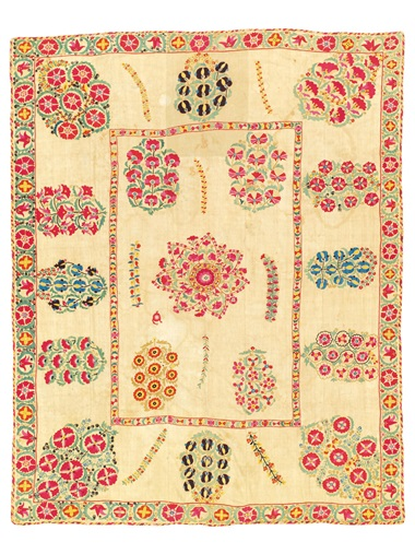 A suzani, Nurata region, Uzbekistan, early 19th Century. 88.34 in x 70 12 in (225.4 x 179cm). Estimate £4,000-6,000. Offered in the Art of the Islamic and Indian Worlds Including Oriental Rugs and Carpets 25 October 2018 at Christie's in London