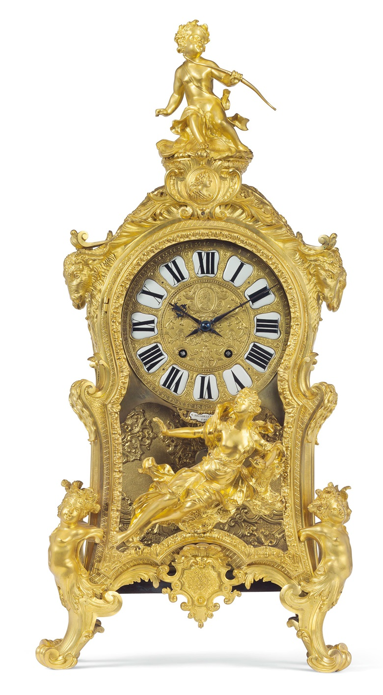 A large French ormolu mantel clock by Alfred-Emmanuel (known as Alfred II) Beurdeley, Paris, late 19th century. 40 in (101.5 cm) high, 19 12 in (49.5 cm) wide, 9 14 in (23.5 cm.) deep. Estimate $10,000–15,000. Offered in A Golden Age An Important Collection of 19th Century Furniture & Decorative Art, 16 October at Christies in New York