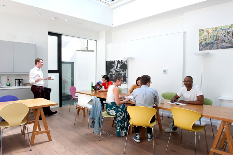 The communal dining space at the new premises at 42 Portland Place, London