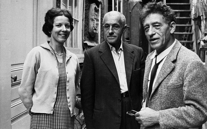 Alberto (right) and Diego Giacometti with their sister Annette in 1960. Photograph by Ernst Scheidegger © The Estate of Alberto Giacometti (Foundation Giacometti, Paris and ADAGP, Paris) licensed