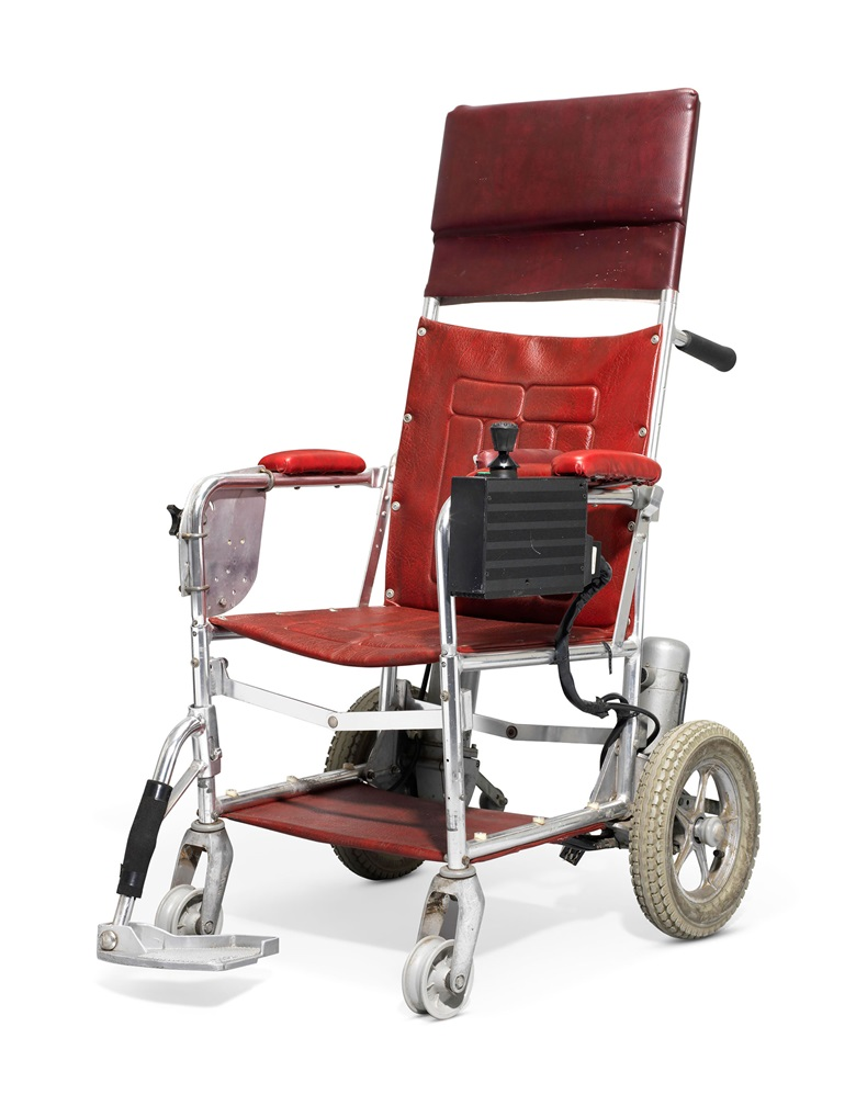 A motorised wheelchair, [Stephen Hawking]. c. 1988. Approx 127 x 58 x 72 cm. Made in England by BEC Mobility, circa 1988 (serial number 440609). Provenance from the estate of the late Professor Stephen Hawking. Estimate £10,000-15,000. This lot is offered in  On the Shoulders of Giants Newton, Darwin, Einstein, Hawking, 31 October to 8 November 2018, Online