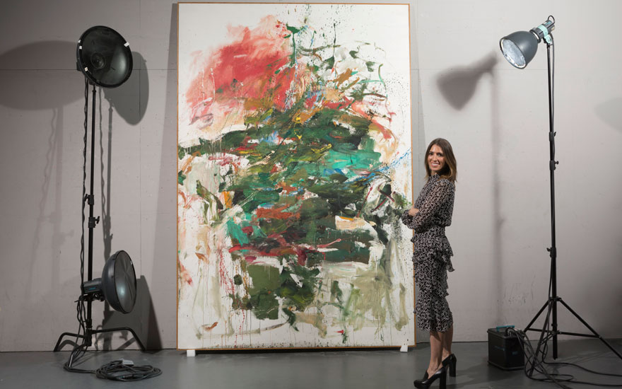 Johanna Flaum with Joan Mitchell's (1925-1992) 12 Hawks at 3 O'Clock, 1960. Estimate $12,000,000–16,000,000. Offered in An American Place The Barney A. Ebsworth Collection Evening