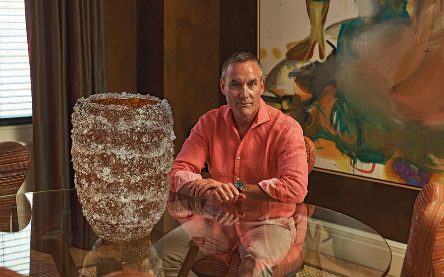 Brian McCarthy with his cherished Murano glass vase designed by Fabio Maria Micucci. Artwork Albert Oehlen, Menschenpemmikan, 2006 (detail). Photograph by Yael Malka. © Albert Oehlen. All