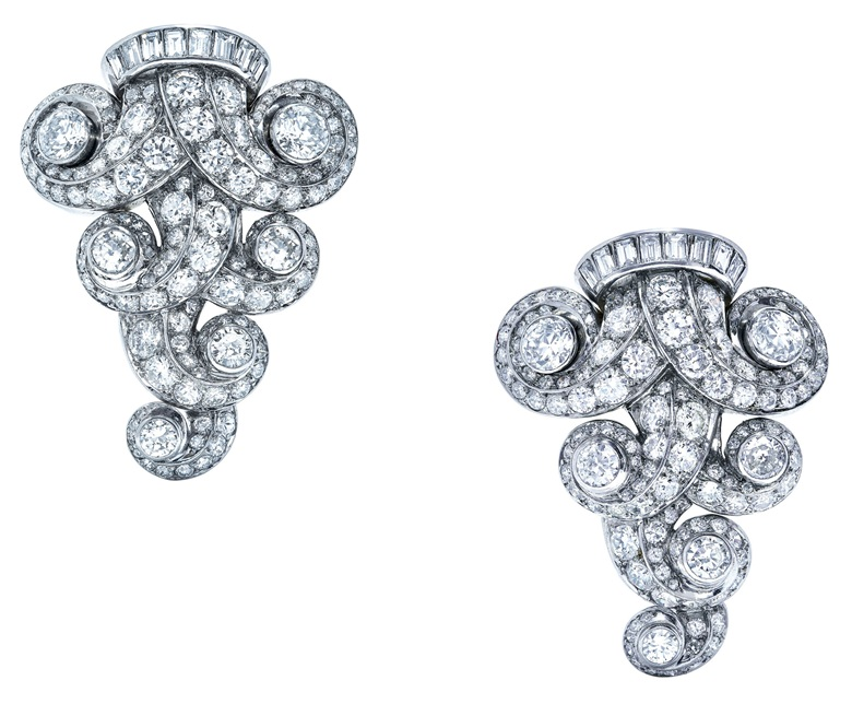 A pair of mid-20th-century diamond brooches, Suzanne Belperron. Old, single, baguette and circular-cut diamonds, platinum (French marks), 1950s, 4.0 cm, maker's marks (Groëne et Darde). Estimate CHF 40,000-60,000. This lot is offered in Magnificent Jewels on 13 November 2018 at Christie's in Geneva