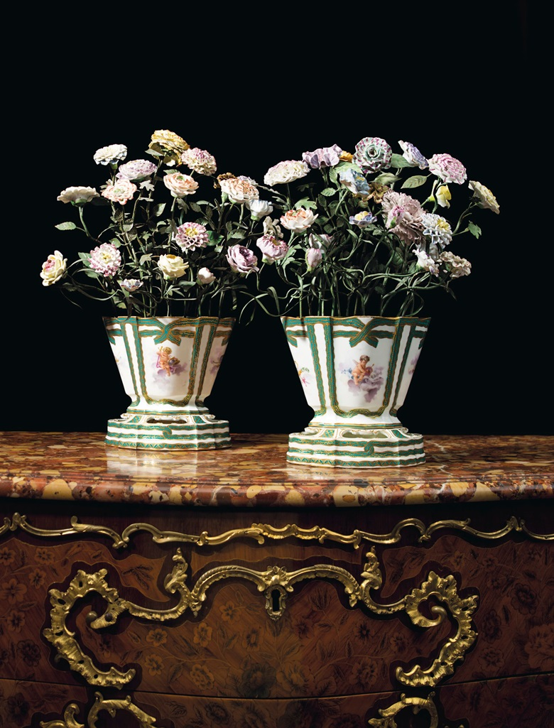 A pair of Sèvres porcelain green-ribboned flower-pots and stands filled with porcelain flowers on tole stems. Estimate $60,000-80,000. Offered in A Love Affair with France The Collection of Elizabeth Stafford on 1 November at Christie's in New York
