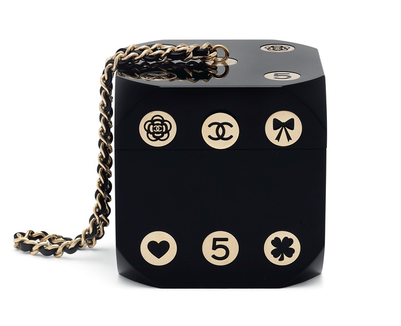 A limited edition runway black lucite casino dice evening bag with gold hardware, Chanel, Fall 2015, £3,000-4,000. Offered in Handbags & Accessories on 12 December at Christie's in London