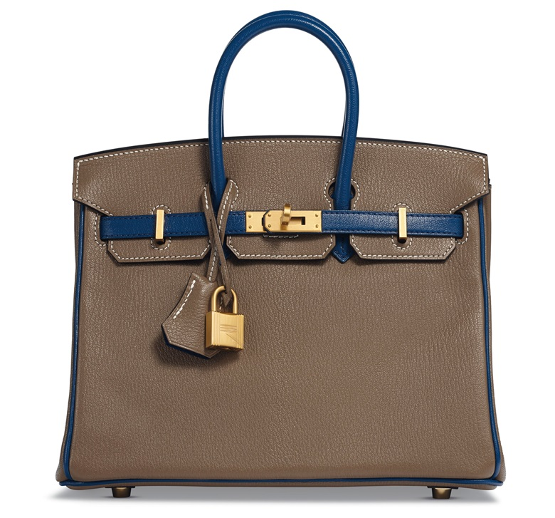 A custom Étoupe & Blue Sapphir Chèvre leather Birkin 25 with brushed gold hardware, Hermès, 2018. Estimate $10,000–15,000. Offered in Handbags & Accessories, 20 November-5 December, Online