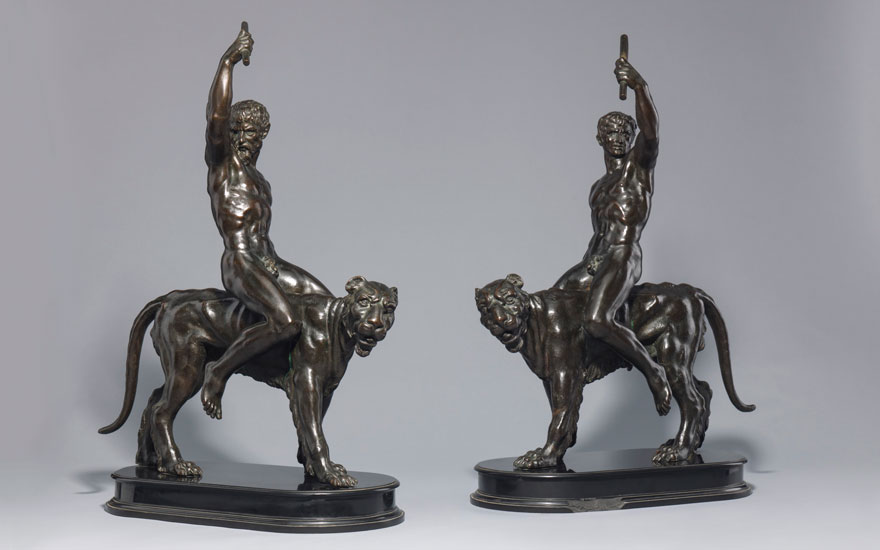 A Pair of Nude Male Figures Astride Panthers, Italian, 17th Century, each on a shaped nero del Belgio marble base; each 65 cm. high, overall. Estimate £200,000-300,000. Offered in European
