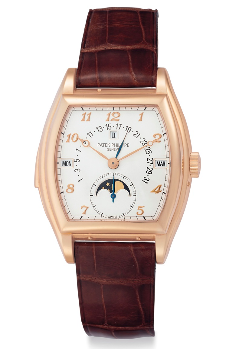 Patek Philippe. An extremely fine and rare 18k pink gold tonneau-shaped automatic minute repeating Perpetual Calendar wristwatch with retrograde date and moon phases. Signed Patek Philippe, Genève, Ref. 5013R, Manufactured in 1998.