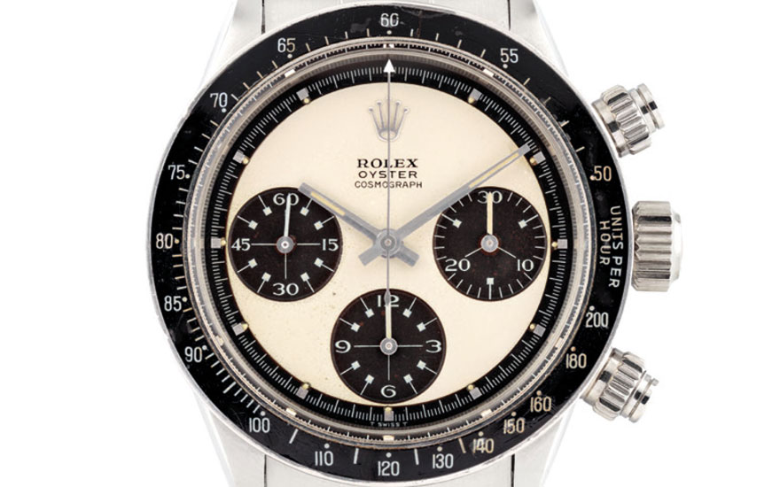 A very rare and extremely attractive stainless steel chronograph Rolex wristwatch with bracelet and Paul Newman Panda dial. Estimate HK$1,750,000-3,200,000. This lot is offered in Important Watches on