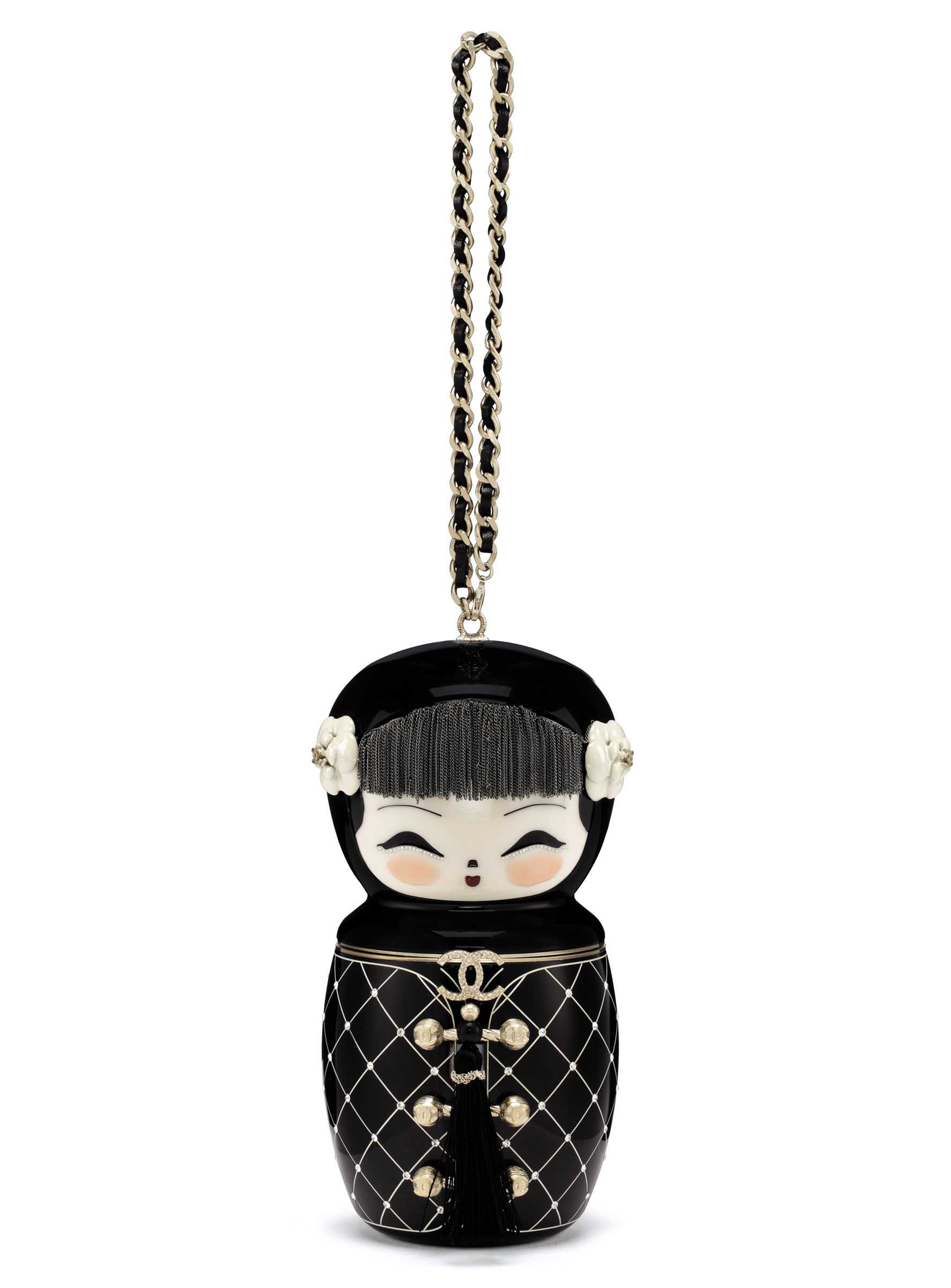 A Métiers dArt Paris-Shanghai black lucite Matryoshka evening bag with gold hardware, Chanel, 2010. 12 w x 19 h x 7 d cm. Sold for $32,500 on 19 June 2018, online