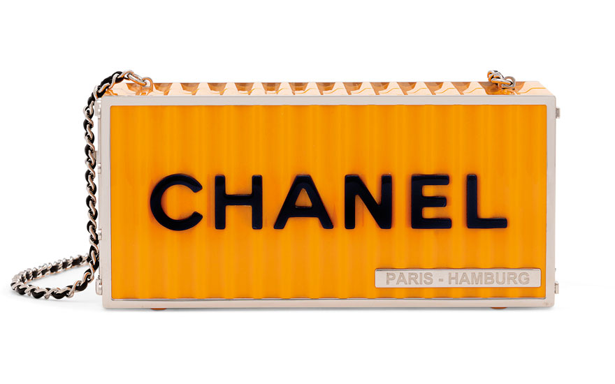 A Métiers dArt Paris-Hamburg yellow lucite Shipping Container evening bag, Chanel, 2018. 19.5 w x 9 h x 8 d cm. Estimate £6,000-8,000. This lot is offered in Handbags & Accessories on
