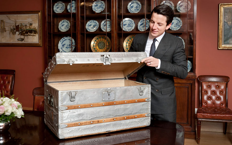 Christie's Head of Handbags & Accessories Matthew Rubinger with the Louis Vuitton trunk he's always wanted in one of his sales. Sold for £162,500 on 12 December 2018 at Christie's in