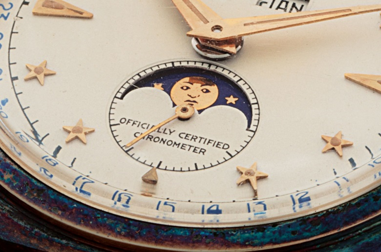 The moon phase disc is adorned with eyes, a nose and a mouth