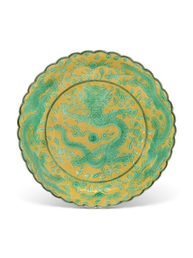 A small yellow and green enamelled dragon dish, Qianlong six-character seal mark in black enamel and of the period (1736-1795). 5¼ in (13.3 cm) diam. Estimate £2,000-4,000. Offered in The Art of China London, Winter Edition, 5-13 December 2018, Online