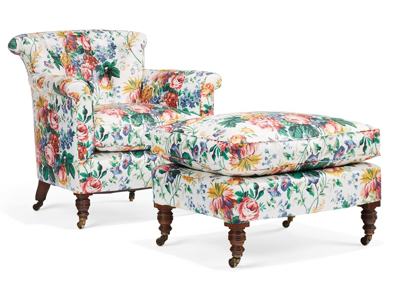 The same chair and ottoman, reupholstered with a traditional chintz fabric. A late victorian stained beechwood club chair and ottoman, by Howard & Sons, late 19th century, with ringturned baluster tapering legs and brass caps and castors and stamped 126669009 Howard and Sons Berners St. Estimate $1,000-1,500. Offered in Little Cassiobury The Collection of Susan Lyall on 16 January 2019 at