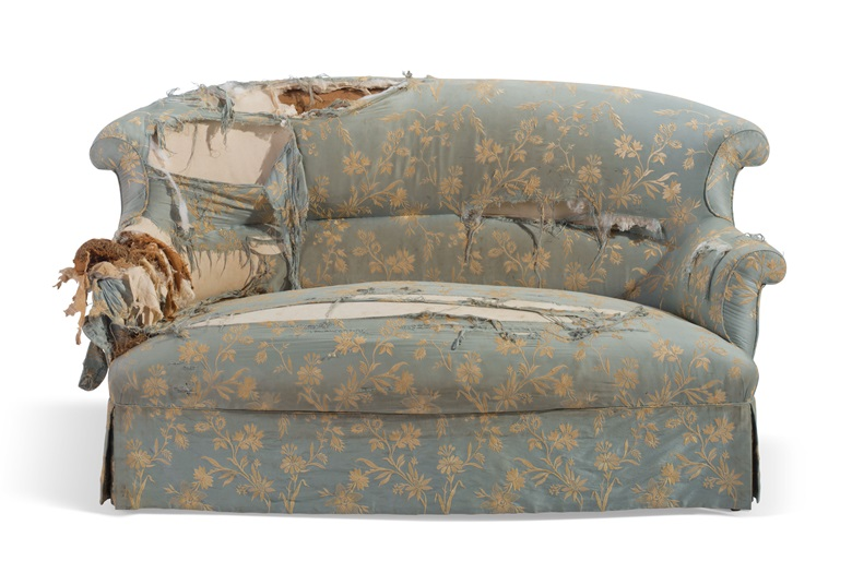 A battered 19th-century settee, before its restoration by Christie's