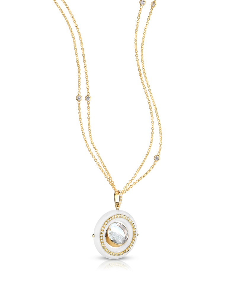 Tagua Halo Pendant by Moritz Glik, diamonds (4.33 carat) set in and enclosed between a white sapphire kaleidoscope shaker in 18 carat yellow gold and tagua nut. Price on request. Offered for sale at Christie's during The Protagonist  event on 10 December