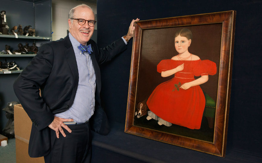 John Hays pictured with Ammi Phillips (1788-1865), Portrait of a Girl in a Red Dress, circa 1834. Estimate $800,000-1,200,000. Offered in Important American Furniture, Folk Art and Silver on