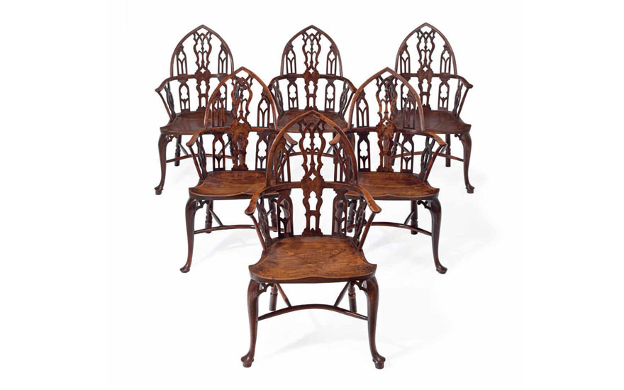 A set of six George III yew and elm Gothick Windsor armchairs, sold for $336,500 in the The Collection of Peggy and David Rockefeller English & European Furniture, Ceramics and Decorations, Part