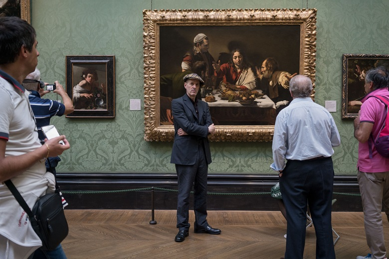Toby Glanville at the National Gallery in London in front of The Supper at Emmaus, 1601, with Caravaggio's Boy Bitten by a Lizard, circa 1594-95, on the left. Photograph by Harry Mitchell