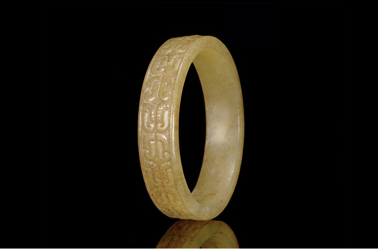 A rare small yellowish-green jade bangle, Warring States period, 5th century B.C. 2¼  in (5.7  cm)  diameter. Sold for $266,500 on 25 March 2010 at Christie's in New York