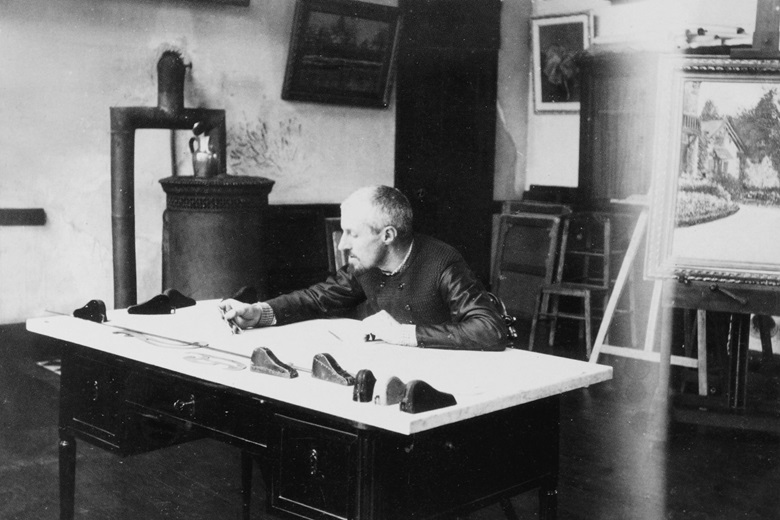 Gustave Caillebotte at his naval architect's drafting table, circa 1891-1892. Photograph by Martial Caillebotte
