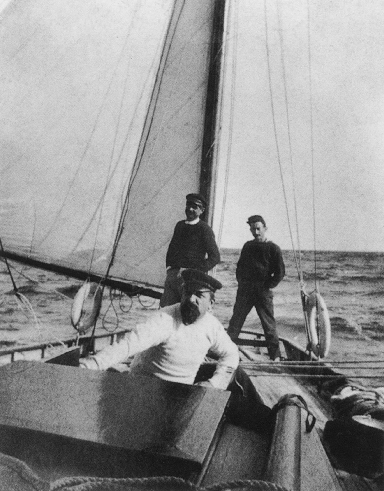 Paul Signac, in the foreground, on his boat Olympia, circa 1895. Photo © Archives Signac