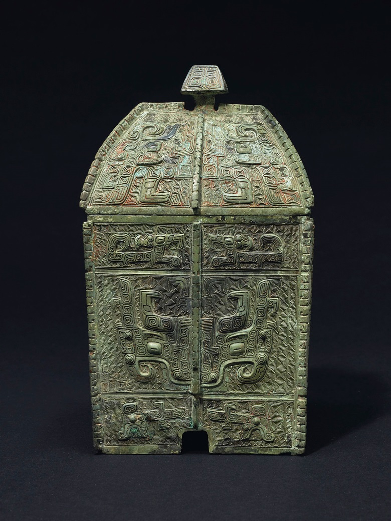 A rare finely cast bronze ritual wine vessel and cover, Fangyi, late Shang dynasty, 13th-11th century BC. 9 in (22.8 cm) high.