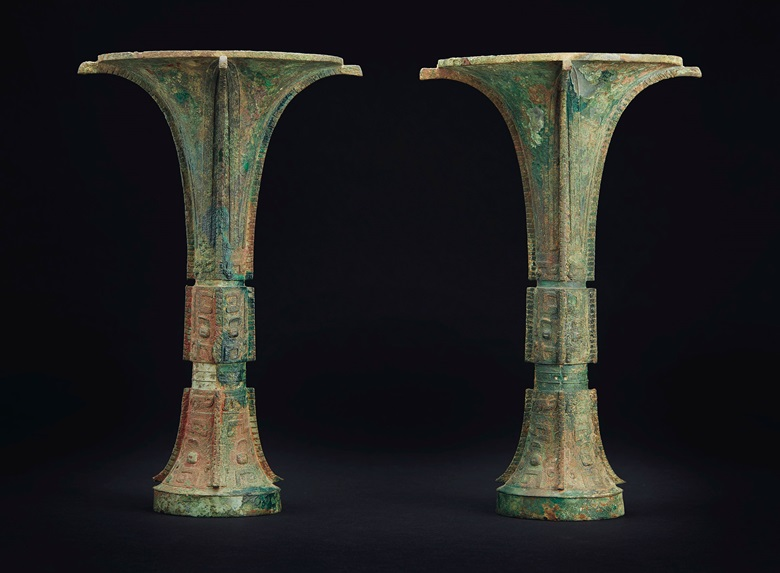 The Tie Zhu Gu. A very rare finely cast pair of bronze ritual wine vessels, late Shang dynasty, 12th-11th century BC. 12¼ in (31 cm) high. Sold for $543,000 on 22 March 2019 at Christie's in New York