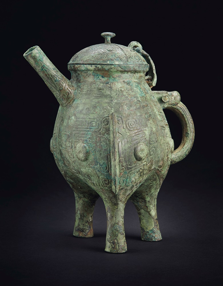 The Ran Fu Bin He, a rare bronze ritual tripod wine vessel and cover, late Shang-early western Zhou dynasty, 11th century BC. 13 in (33 cm) high.