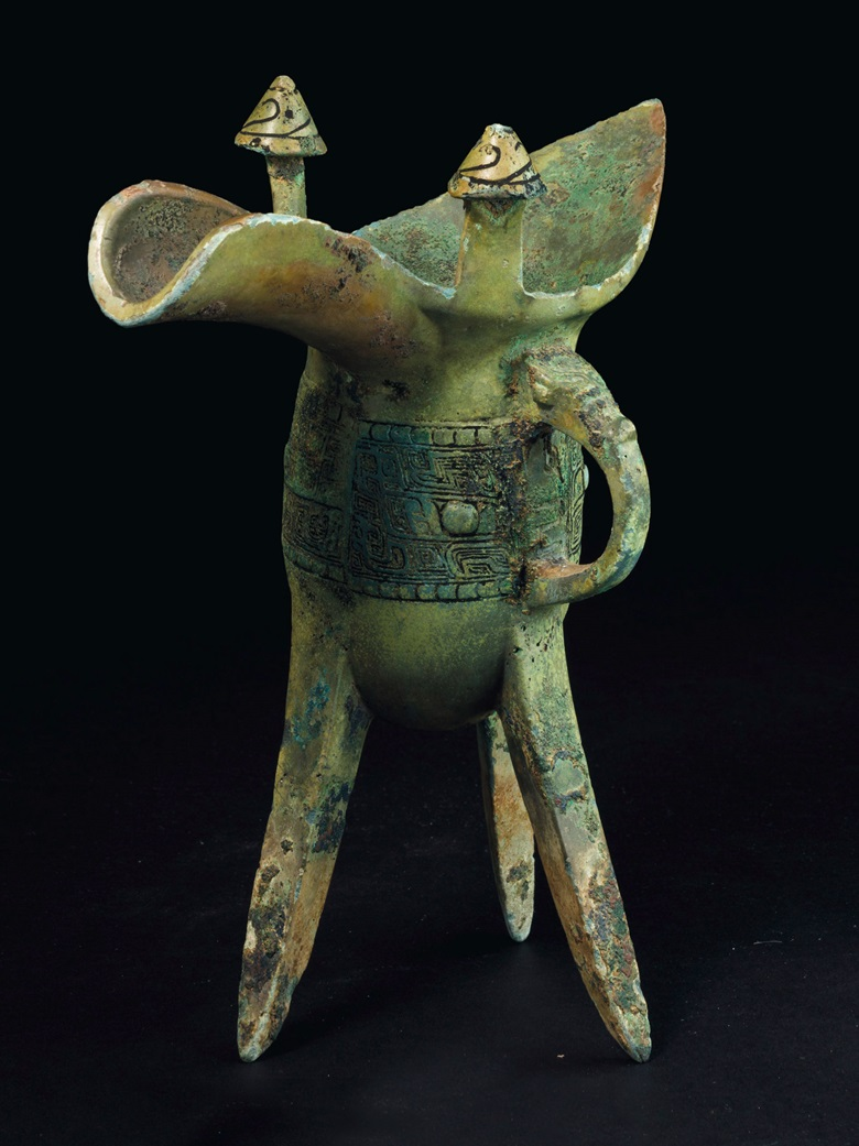 A bronze ritual tripod wine vessel, Jue, Late shang dynasty, 13th-11th century bc. 8 in. (20.3 cm.) high. Sold for $32,500 on 22-23 March 2018 at Christie's in New York
