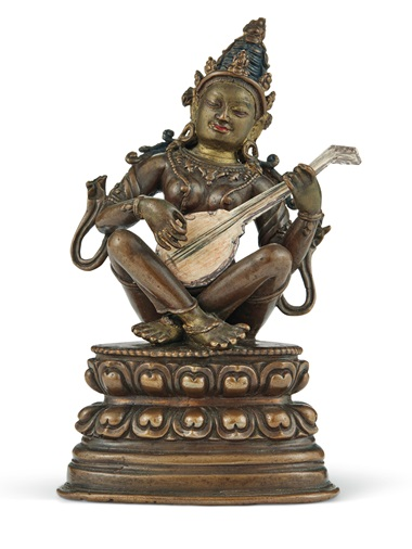 The bronze figure of Sarasvati with the lute Baroness Eva Bessenyey drew, cut out and placed in her lap
