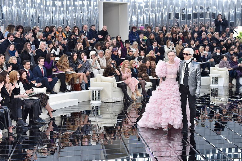Karl Lagerfeld with a model at the Chanel Spring-Summer 2017 haute couture collection show on 24 January 2017 in Paris. Photo Victor VIRGILEGamma-Rapho via Getty Images