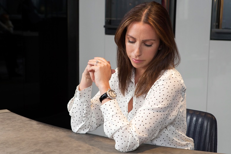 Rebecca Ross wears a Breguet, 18k white gold and diamond-set minute-repeating watch