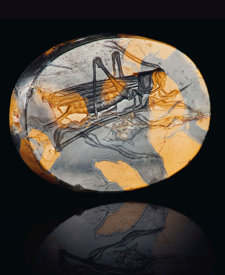 A Greek mottled yellow jasper scaraboid with a grasshopper, circa late 5th century BC. Estimate $30,000-50,000. Offered in Antiquities on 29 April 2019 at Christie's in New York