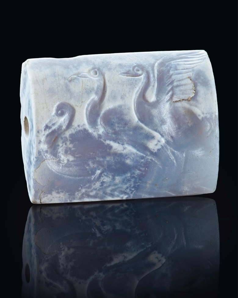 A Minoan blue chalcedony tabloid seal with three swans, circa 16th century BC. Estimate $50,000-70,000. Offered in Masterpieces in Miniature Ancient Engraved Gems Formerly in the G. Sangiorgi Collection on 29 April 2019 at Christie's in New York