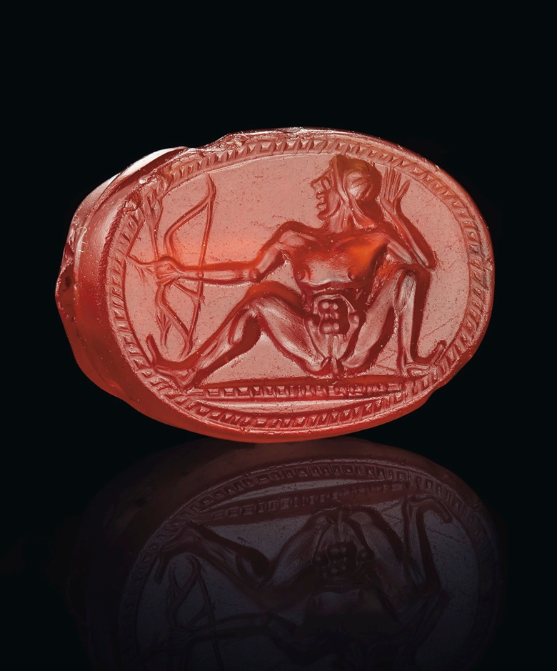 A Greek carnelian scarab with a nude archer, circa early 5th century BC. Estimate $25,000-35,000. Offered in Masterpieces in Miniature Ancient Engraved Gems Formerly in the G. Sangiorgi Collection on 29 April 2019 at Christie's in New York