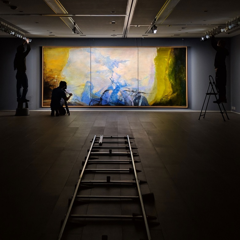 Zao Wou-Ki's Triptyque 1987-1988  being installed at Christie's ahead of its Hong Kong preview