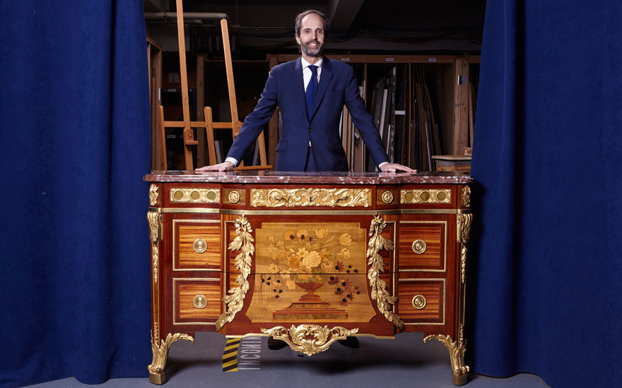 William Stafford, European Furniture and Decorative Arts specialist at Christie's in New York, with an 18th-century Riesener commode, dating to 1774.