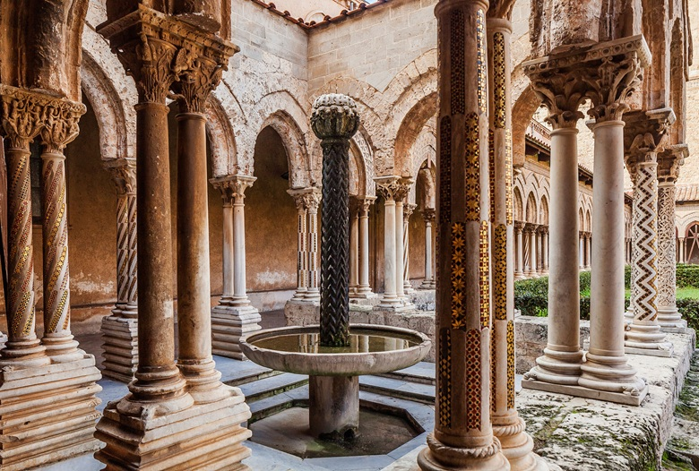 The Moorish fountain in the cloister of the Benedictine abbey next to Monreale cathedral, from the centre of which sprouts an abstracted stone likeness of a palm tree. Photo Antonino Bartuccio4Corners