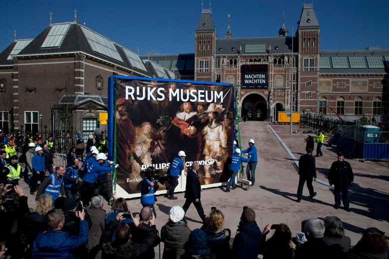 The Night Watch is drawn through the streets of Amsterdam ahead of the reopening of the Rijksmuseum in March 2013. Photo AP PhotoPeter DejongRexShutterstock
