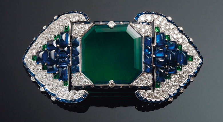 An Art Deco emerald, sapphire and diamond belt buckle-brooch, Cartier, 38.71 carats. Estimate $500,000-700,000. Offered in Maharajas & Mughal Magnificence on 19 June 2019 at Christie's in New York