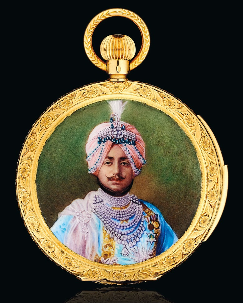 An enamel and gold hunting case minute repeating pocket watch, champlevé enamel portrait depicting Maharaja Bhupinder Singh of Patiala, enamel coat of arms on the reverse, white enamel dial, 18k gold, 2½ in., circa 1930. Estimate $30,000-50,000. Offered in Maharajas & Mughal Magnificence on 19 June 2019 at Christie's in New York