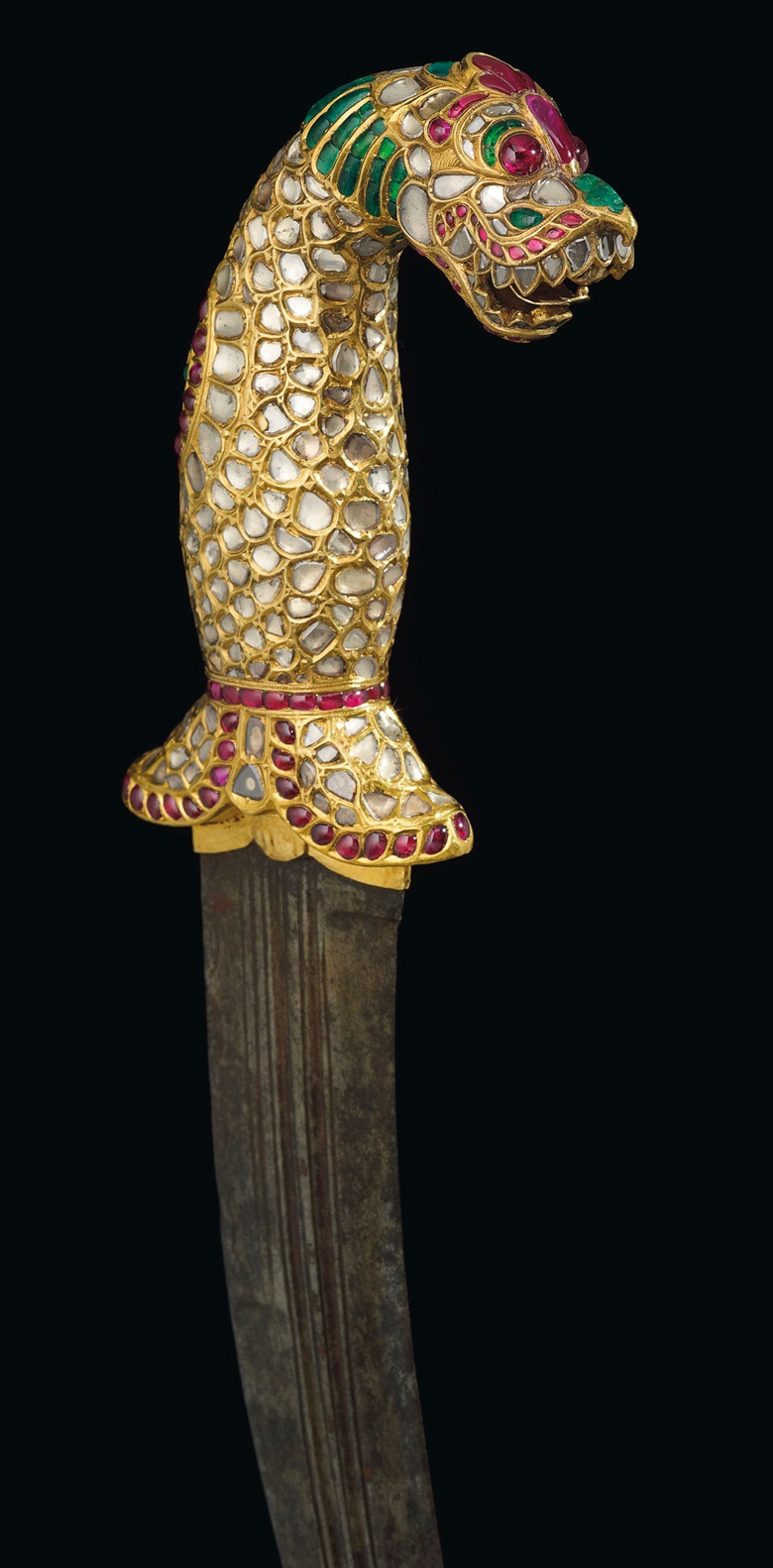 A gold gem set hilted dagger (kinjal), Tanjore or Mysore, south India, 1790-1810. 13⅜  ins (34.1  cm) long. Estimate $500,000-700,000. Offered in Maharajas & Mughal Magnificence on 19 June 2019 at Christie's in New York